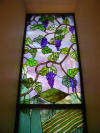 Stained glass window Tuscan scene with grapes closeup1