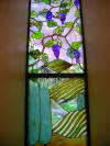 Stained glass tuscan scene with grapes window