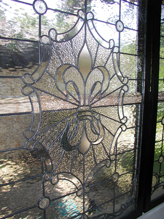 Custom leaded clear textured glass window set featuring a fluer di lis and victorian elements