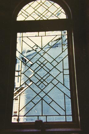Abstract leaded glass window with bevels
