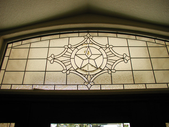Leaded glass transom window with texas star