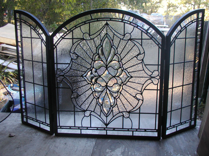 Leaded glass fireplace screen incorporating clear textured glasses and