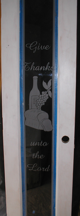 custom carved glass, custom etched glass, custom designed etched and carved glass