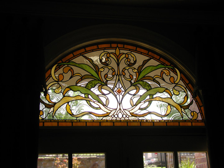Leaded stained glass transoms with in an Art Nouveau style