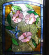 Custom leaded glass door panel with flowers and hummingbird