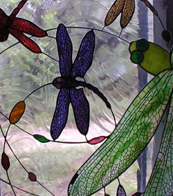 Swirling dragonflies stained glass with photo fused border