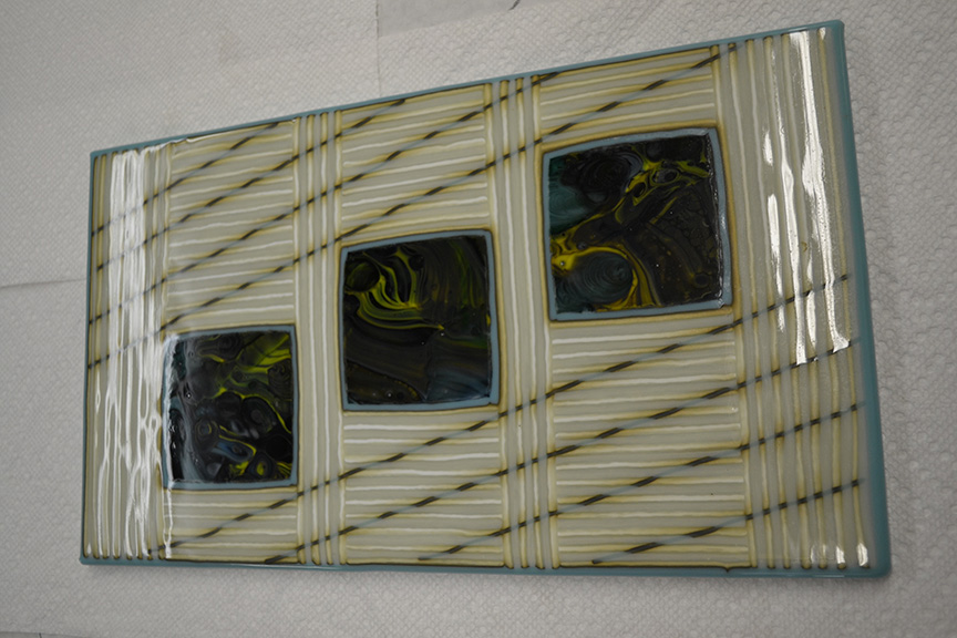 Screen melt pieces used in a strip construction project
