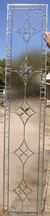 Beveled and clear textured glass sidelite