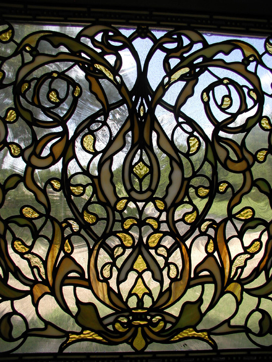 very detailed leaded stained glass transom window