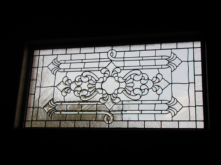 Leaded beveled and clear textured glass transom