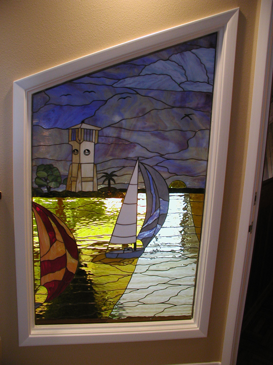 Stained Glass Scene With Lighthouse And Sailboats